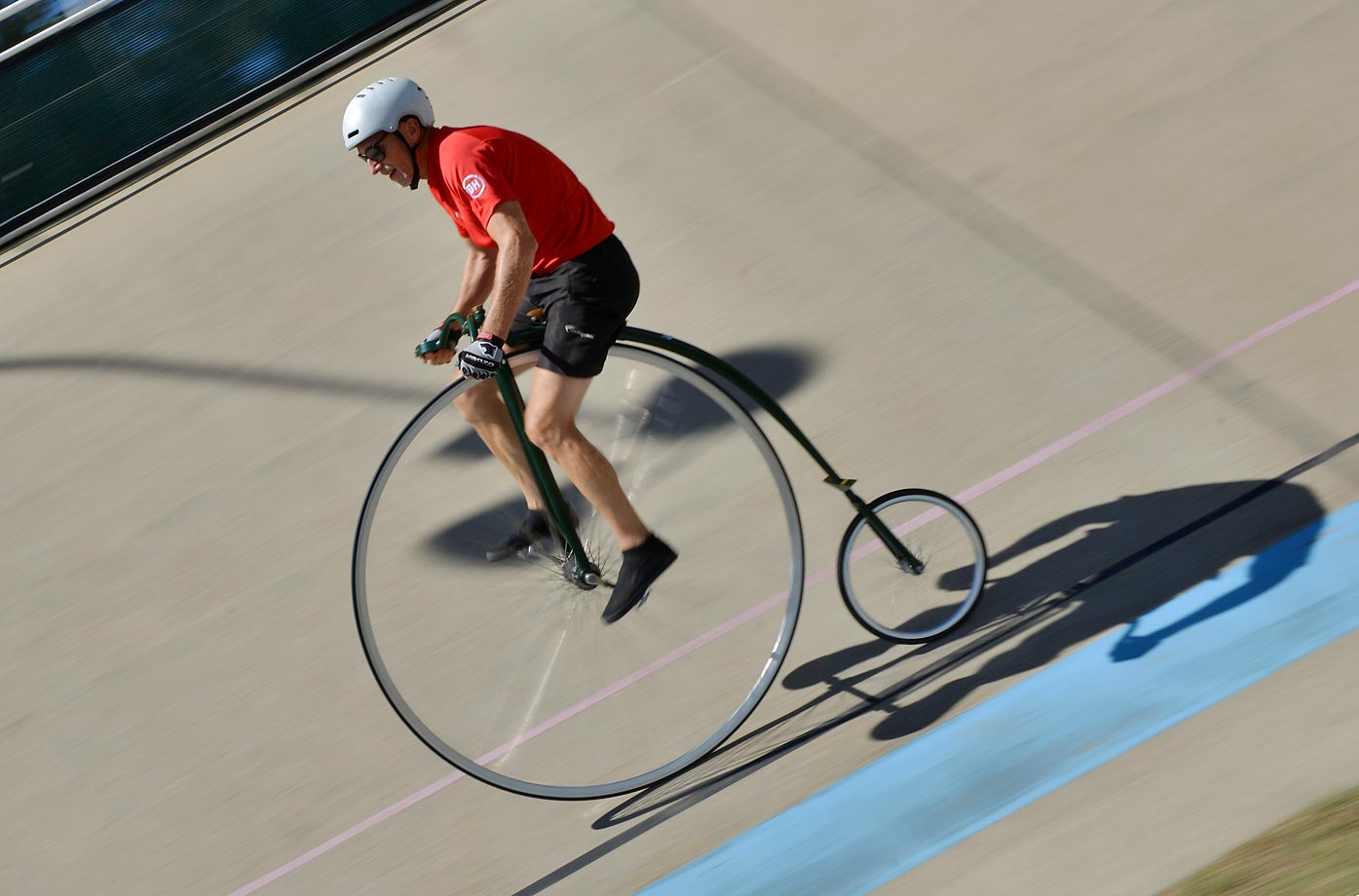 A cyclist races a penny farthing bicycle at the 2015 Sydney Classic Bicycle Show.