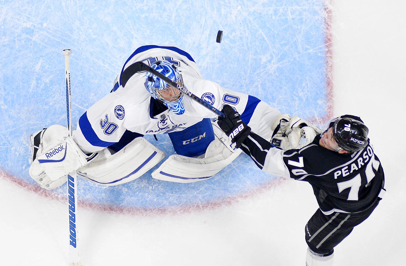 Tanner Pearson of the Los Angeles Kings tries to score on Ben Bishop of the Tampa Bay Lightning. The Kings won 3-1.