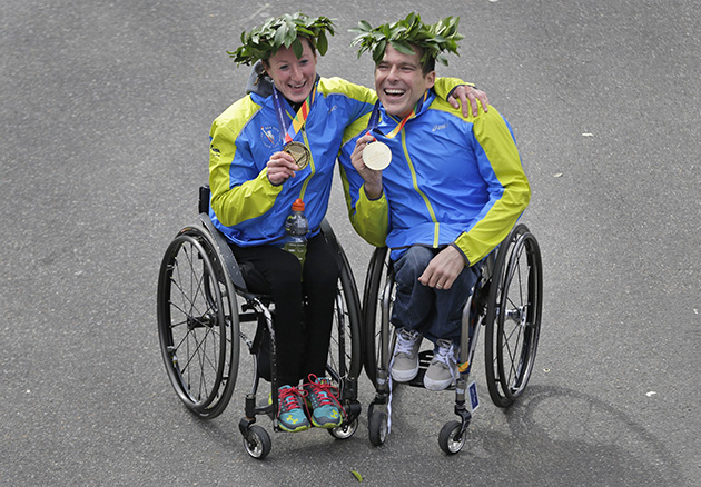 Kurt Fearnely and Tatyana McFadden, first place finishers in the wheeler divisions, pose for a picture at the 2014 New York City Marathon.