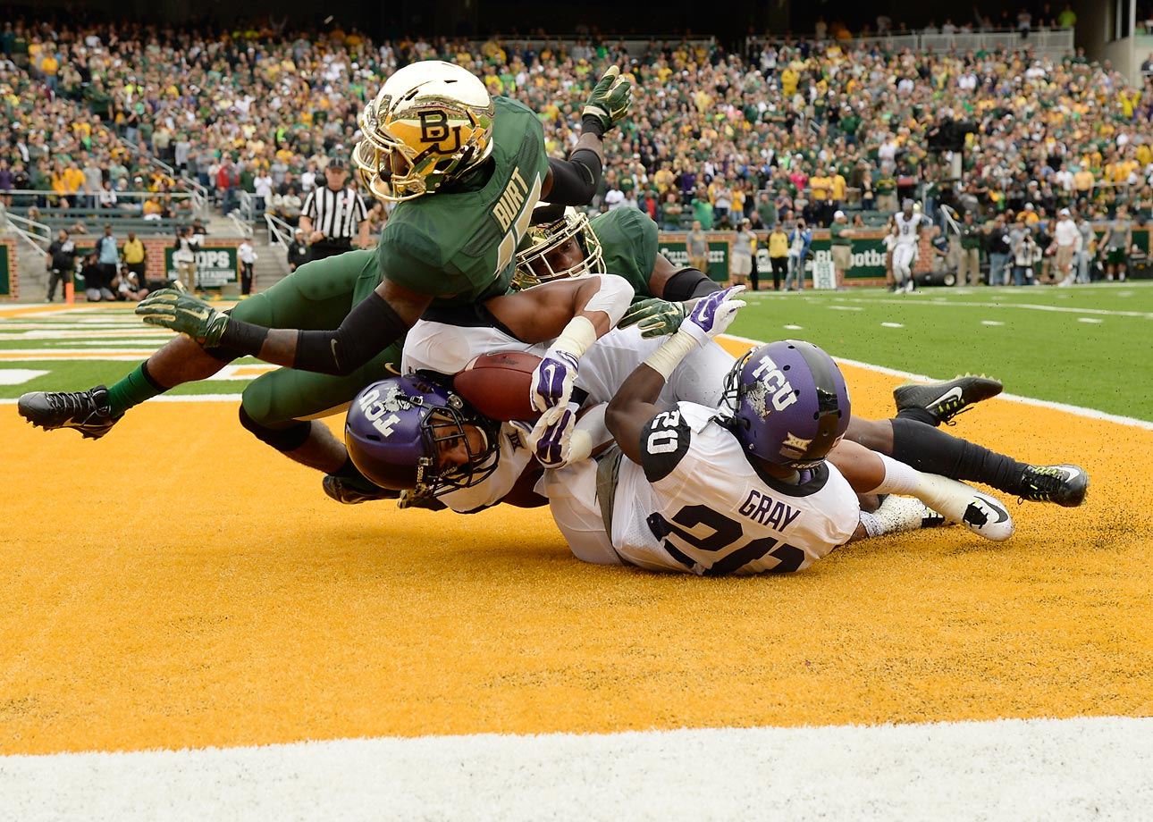 Kolby Listenbee of TCU catches a 35-yard touchdown pass against rival Baylor. Baylor came back from a 21-point deficit to win 61-58.