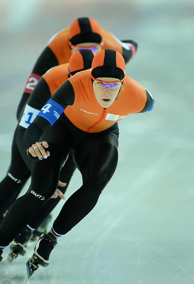 Irene Wust (4), Jorien Ter Mors (1) and Marrit Leenstra of the Netherlands compete in the women's speed skating team pursuit semi-finals.  They won the gold.