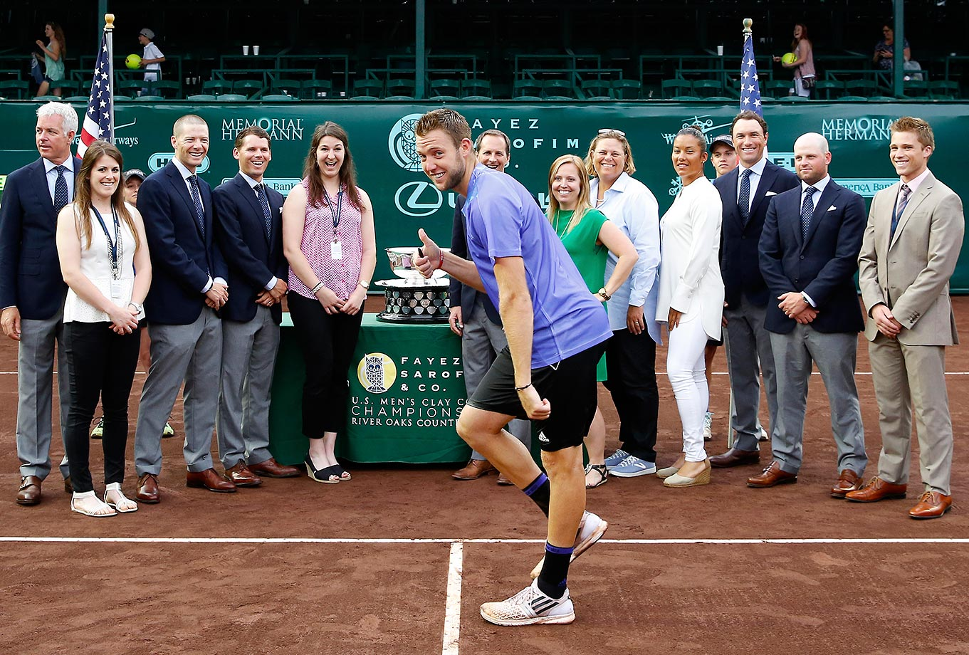 Jack Sock photobombs a group picture after defeating Sam Querrey at the U.S. Men's Clay Court Championships at River Oaks Country Club.