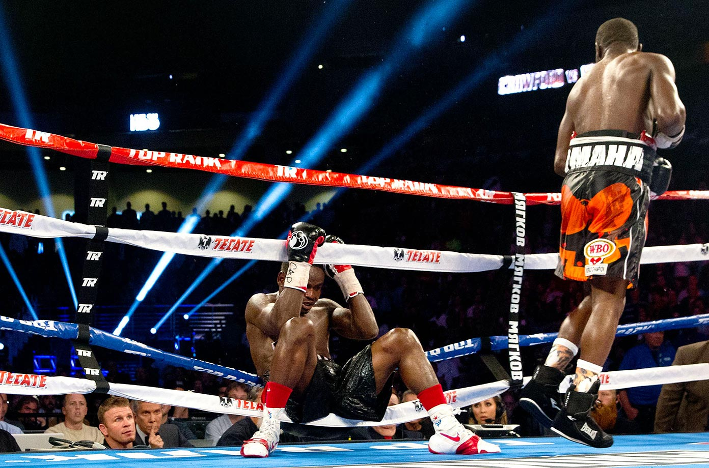 Dierry Jean gets knocked through the ropes by Terence Crawford in the 10th round of a WBO junior welterweight title fight.