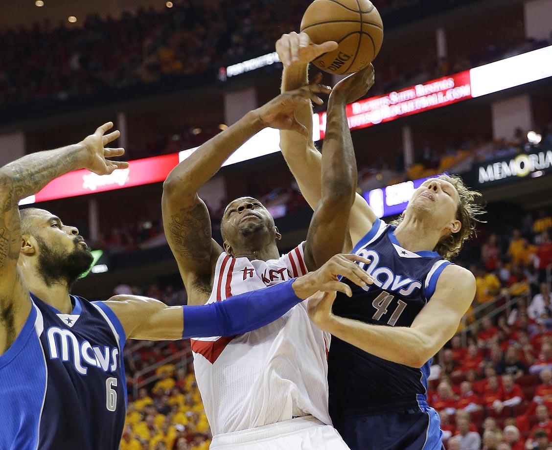 Rockets' Terrence Jones and Mavericks' Dirk Nowitzki.