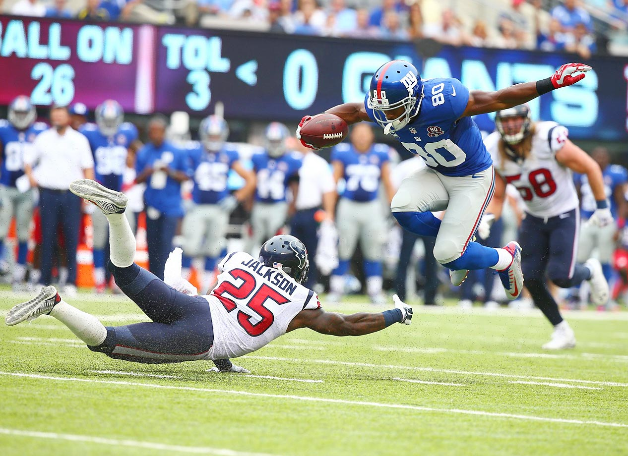 Victor Cruz of the Giants tries to get by Kareem Jackson during New York's 30-17 win against the Texans on Sunday.