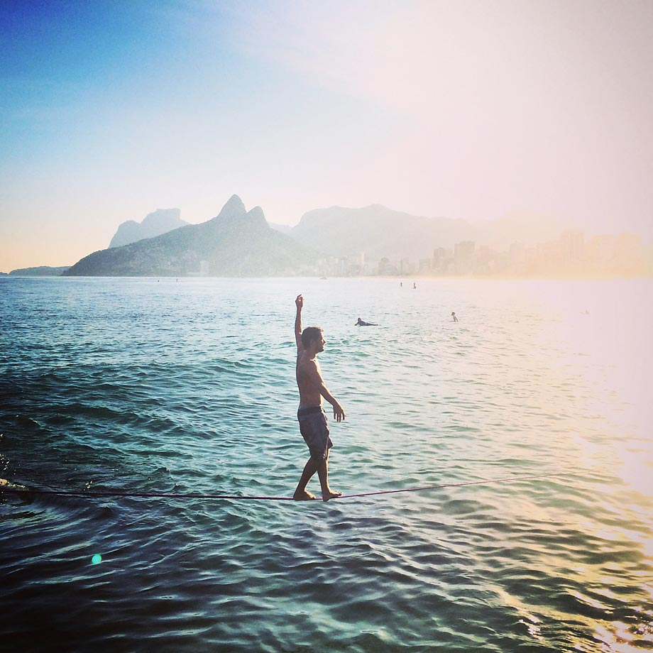 A man walks on a slackline across the ocean at Ipanema beach on June 8, 2014, in Rio de Janeiro, Brazil. Slacklining differs from tightrope walking in that the line is dynamic, allowing performers like the toga-wearing Lewis to bounce on the line like it's a long and narrow trampoline.