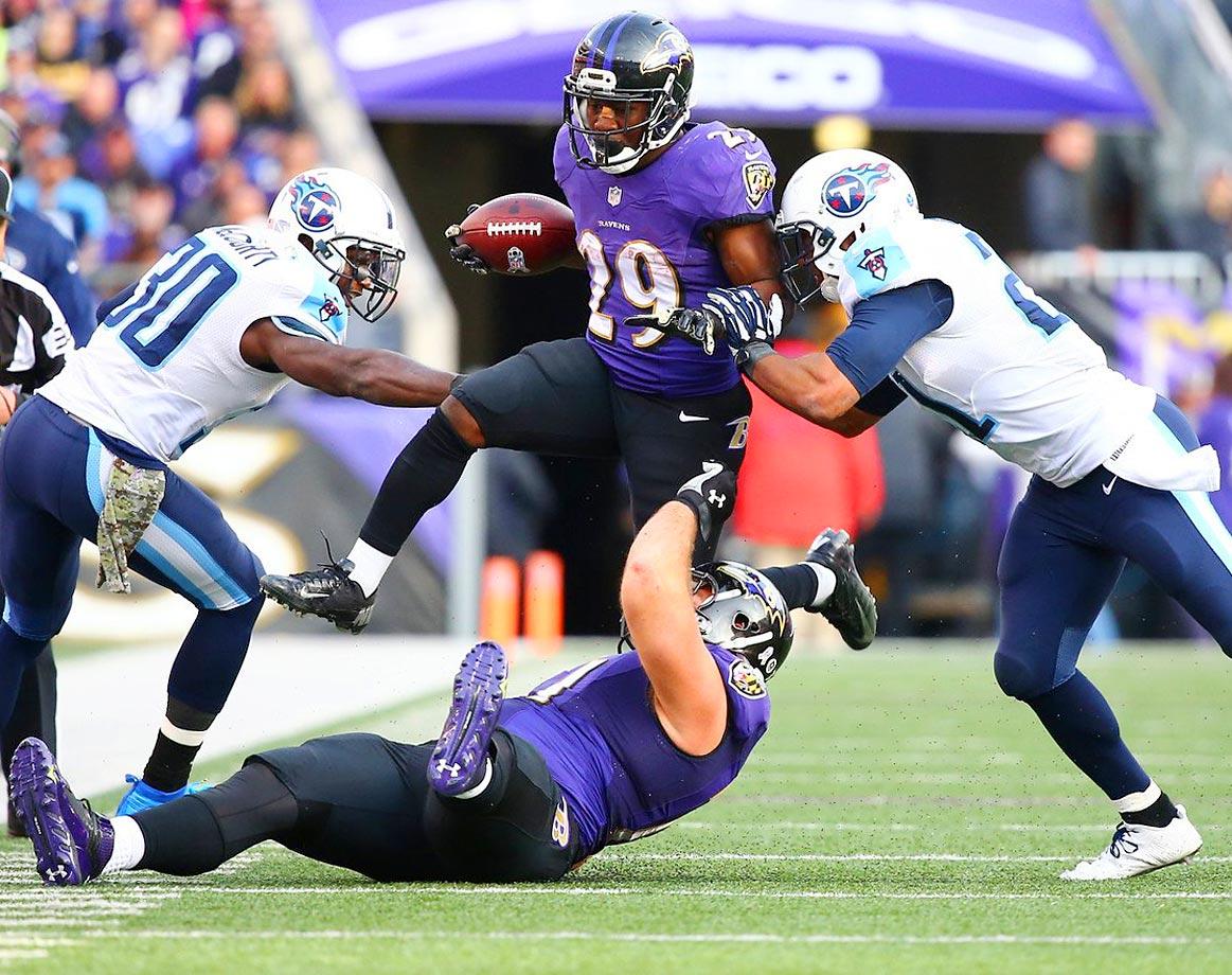 Baltimore Ravens running back Justin Forsett attempts to get past Tennessee Titans defenders. Forsett finished with two touchdowns in the 21-7 win.