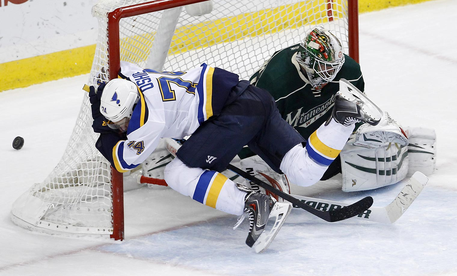 St. Louis Blues right wing T.J. Oshie hits the post after colliding with Minnesota Wild goalie Niklas Backstrom during overtime. The Blues won 3-2 in a shootout.