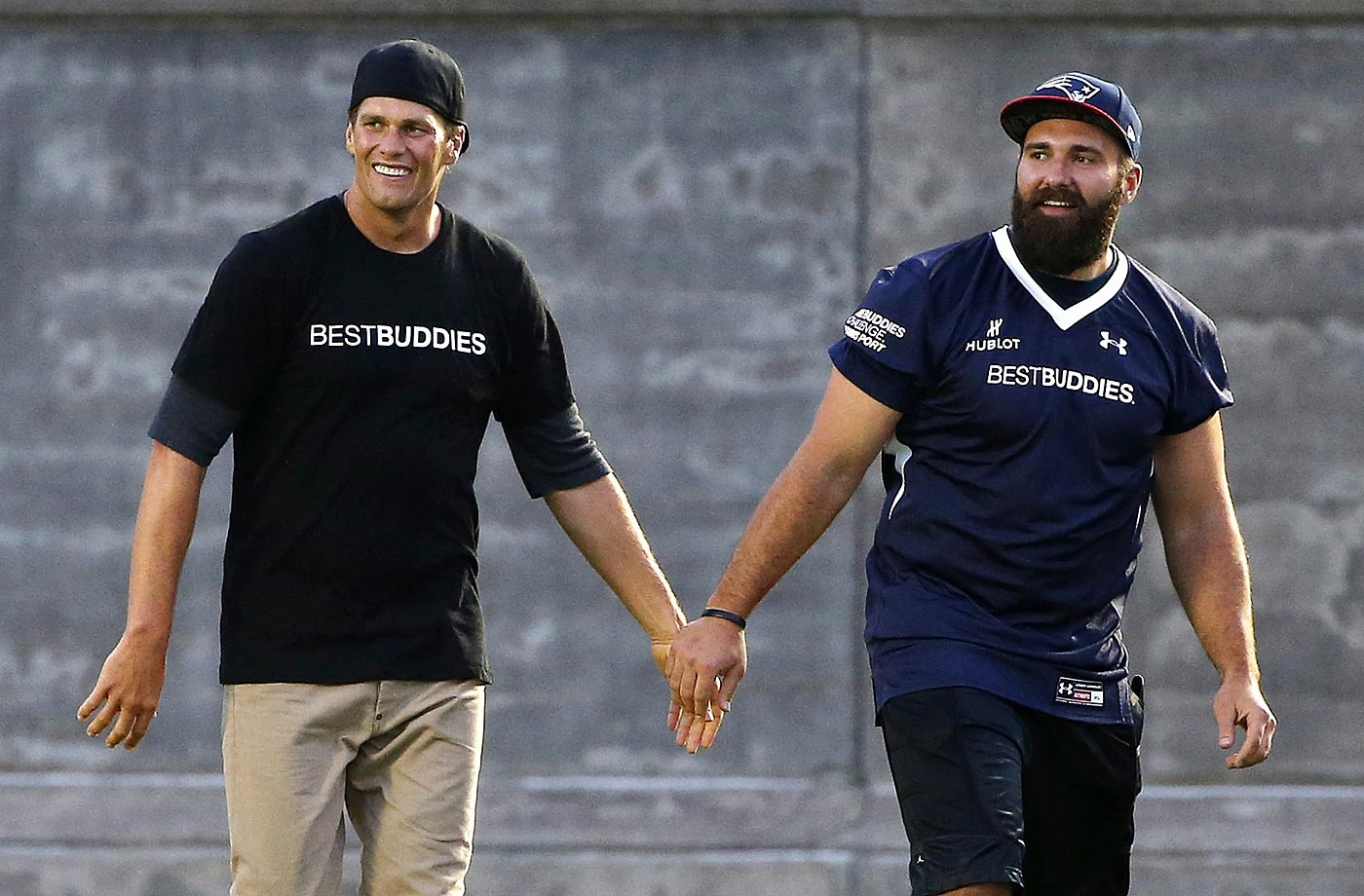 Tom Brady and Rob Ninkovich of the New England Patriots after they played in the Best Buddies Challenge charity football game.