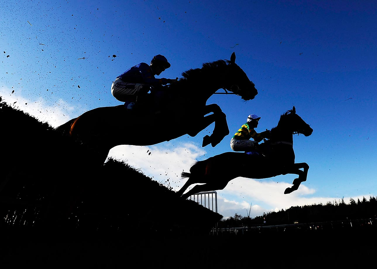 Tony McCoy (right) rides Jollyallan to victory at the Bathwick Tyres Plymouth Novices' Hurdle Race.