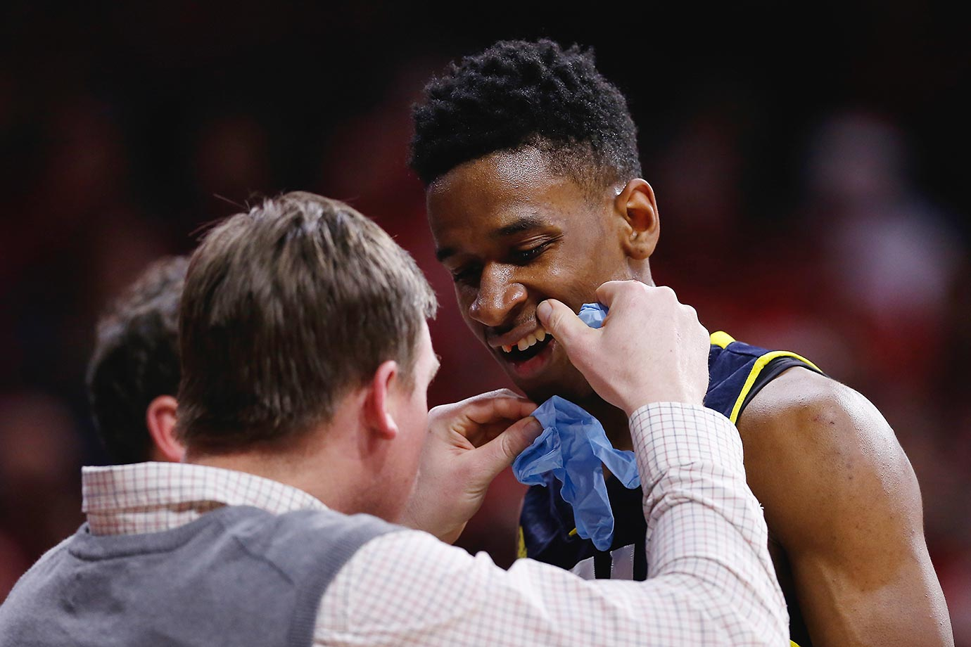 Torry Johnson of the Northern Arizona Lumberjacks gets a tooth knocked out during a game against the Arizona Wildcats.