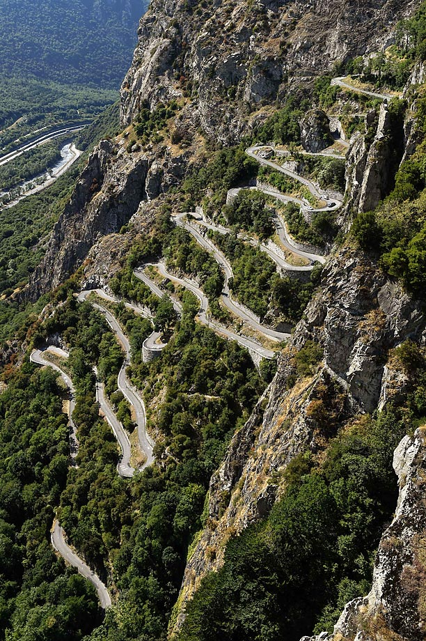 Cyclists climb the Lacets de Montvernier during the 18th stage of the Tour de France.