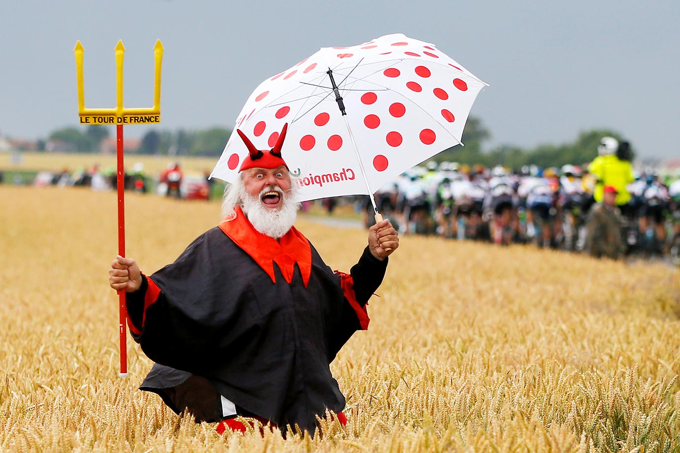 "Dieter ""Didi"" Senft, the self styled ""Devil"" of the Tour de France, cheers on the riders during stage five of the 2015 Tour de France."
