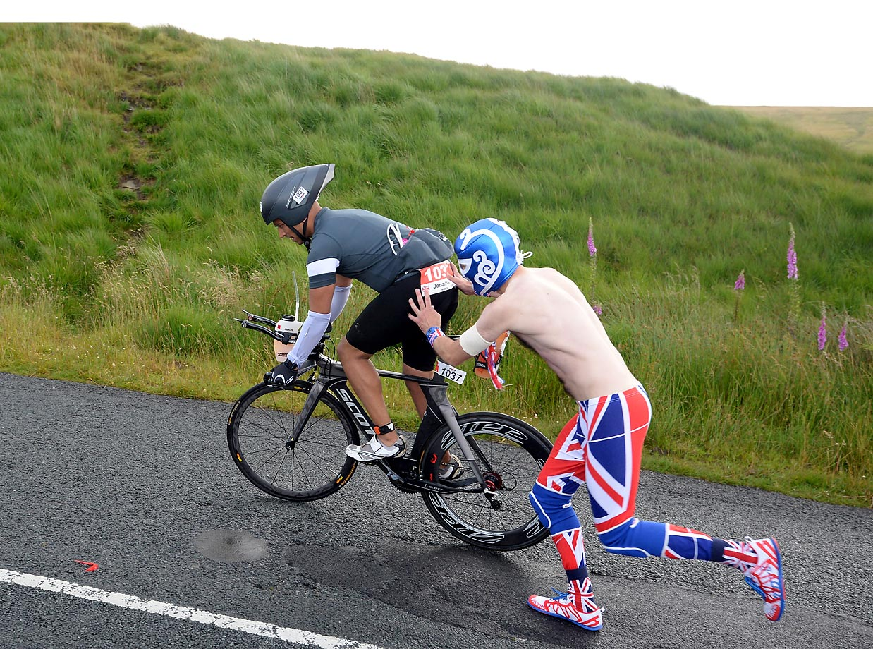 It looks like the typical Tour de France fan, but this rider is getting support from a fan at the Ironman UK race on July 19.