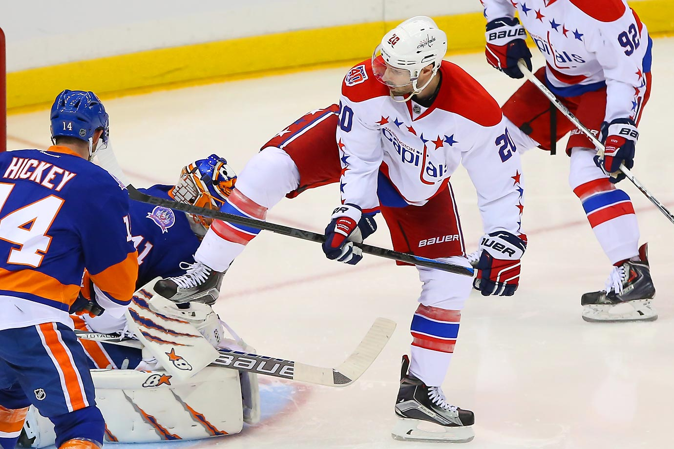 Troy Brouwer of the Capitals battles against Islanders goalie Jaroslav Halak. New York defeated the Washington Capitals 2-1 in overtime in Game 3.