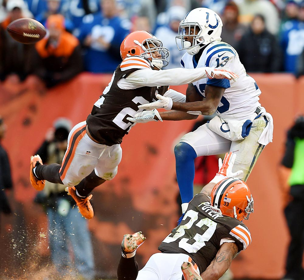 T.Y. Hilton of the Colts can't make a catch between Buster Skrine and Jordan Poyer of the Browns.