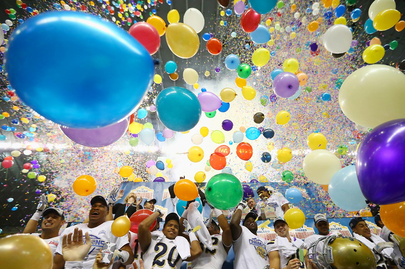 The UCLA Bruins celebrate their 40-35 win against the Kansas State Wildcats during the Valero Alamo Bowl in San Antonio.
