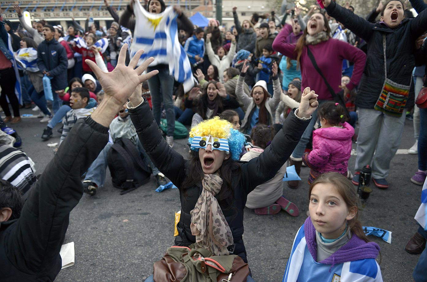 Fans of Uruguay's national soccer team react in downtown  Montevideo, Uruguay.