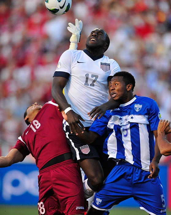 Jozy Altidore rises over Honduras goalkeeper Noel Valladares (18) and defender Jose Velasquez (5) on a corner. Altidore would score in the 73rd minute for a 1-0 U.S. win, June 18, 2013, in Sandy, Utah.