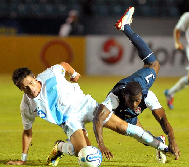 Elias Vasquez of Guatemala and Maurice Edu of the U.S. fight for the ball. The teams drew 1-1 in Guatemala City, on June 12, 2012.