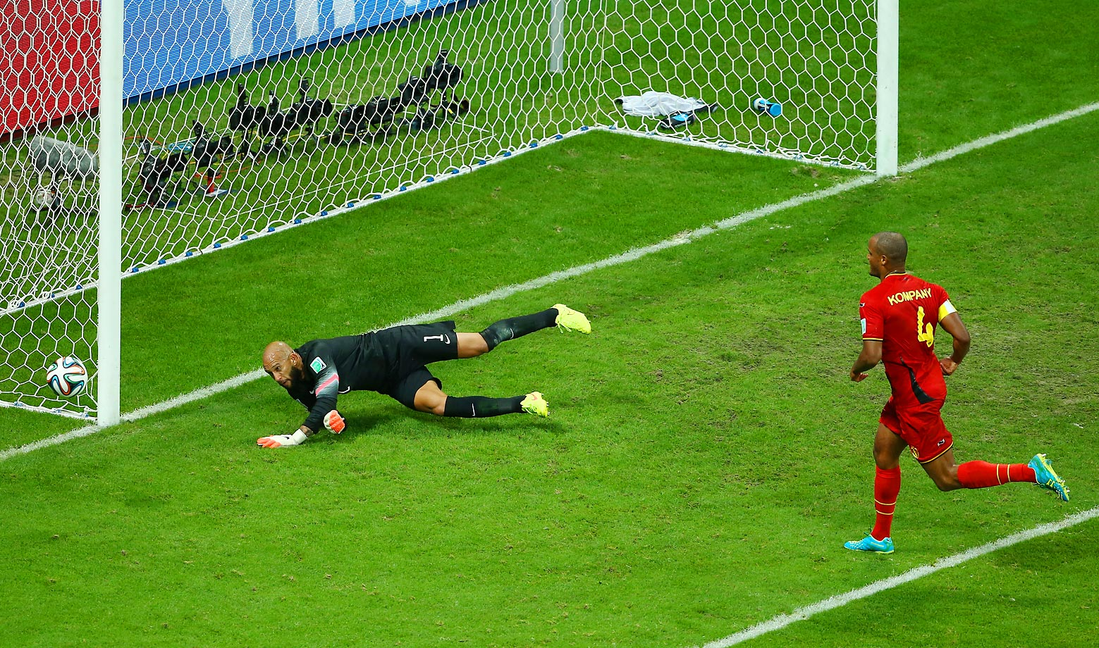 American goalie Tim Howard saves Belgian defender Vincent Kompany's shot in the second half.