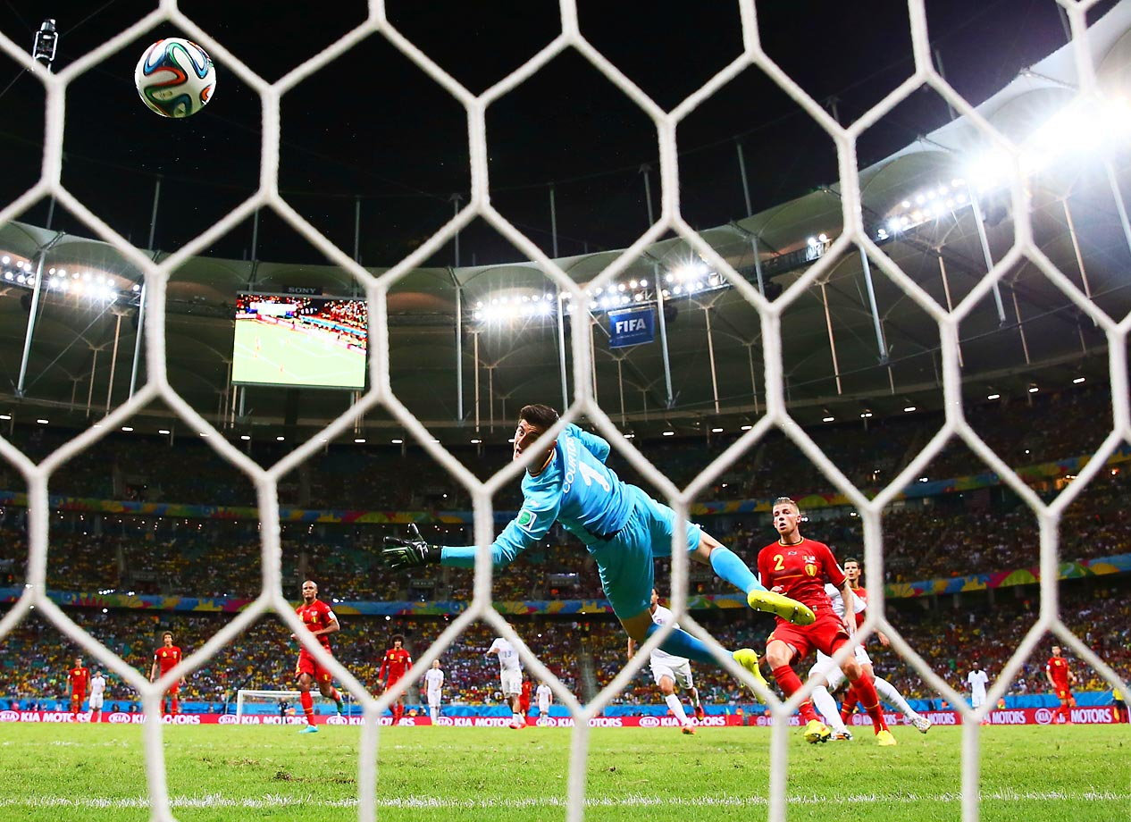 Belgian goalie Thibaut Courtois looks behind him as American substitute Julian Green's shot goes in to make the score 2-1.