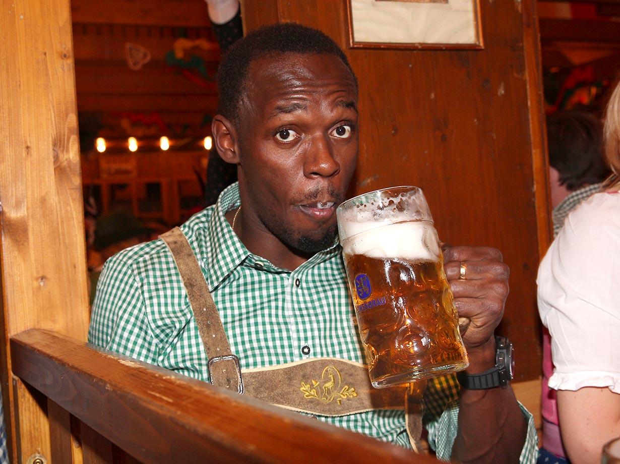 Usain Bolt enjoys a beer at Oktoberfest in Munich.