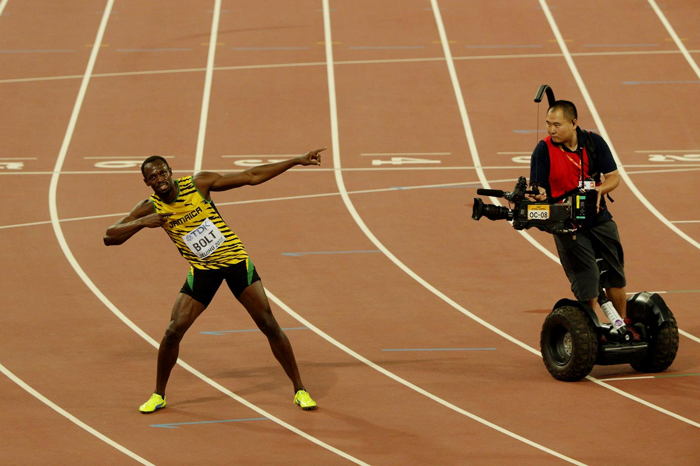 Usain Bolt holds the pose for the man on the Segway at the Track and Field Championships in Beijing.