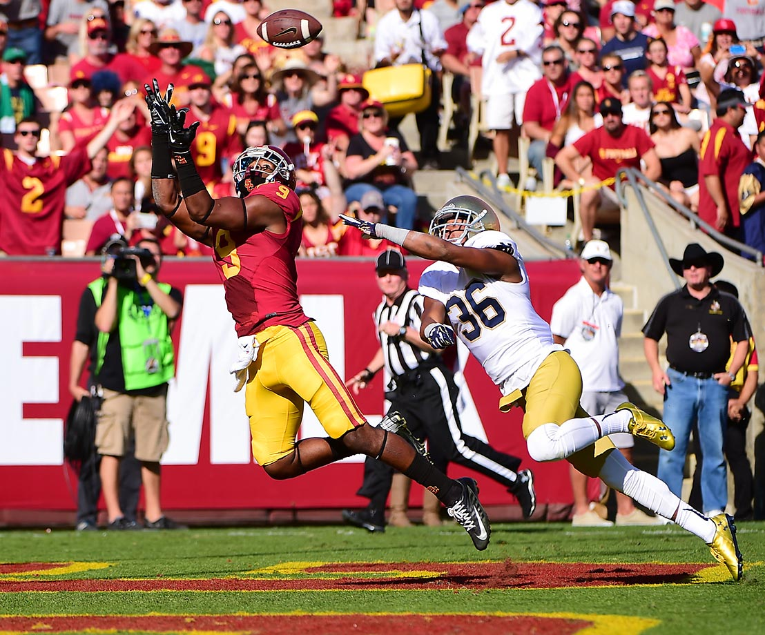 Trojans receiver Juju Smith makes a catch and beats out Notre Dame cornerback Cole Luke to the end zone. USC beat Notre Dame 49-14.
