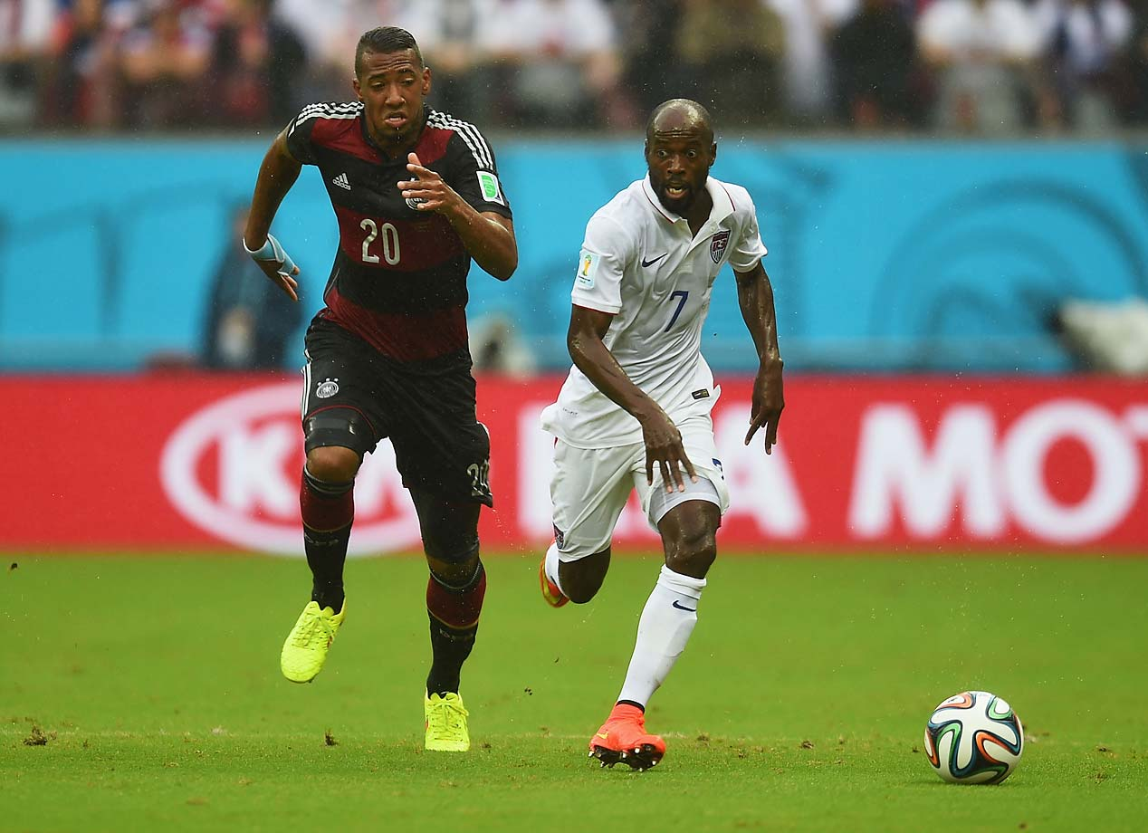 Jerome Boateng of Germany and DaMarcus Beasley attempt to get to the ball first.