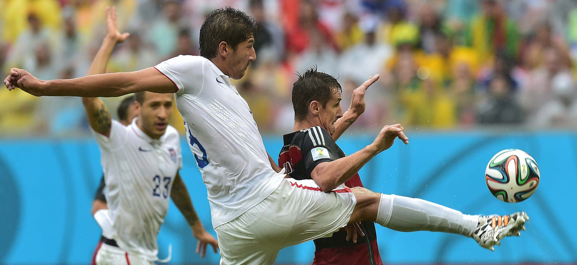 Omar Gonzalez played standout defense for the U.S., including on this play against Miroslav Klose. The Germans, three-time World Cup champions, finished with seven points to win the group, while the U.S. had four and finished second.