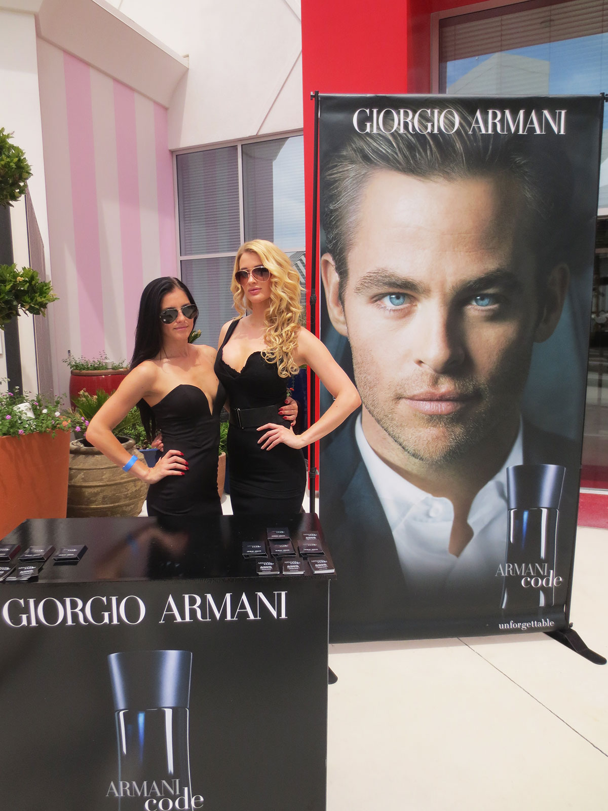 Brand ambassadors hand out Armani Code samples at Foxtail Pool Club at the SLS Las Vegas Hotel & Casino.
