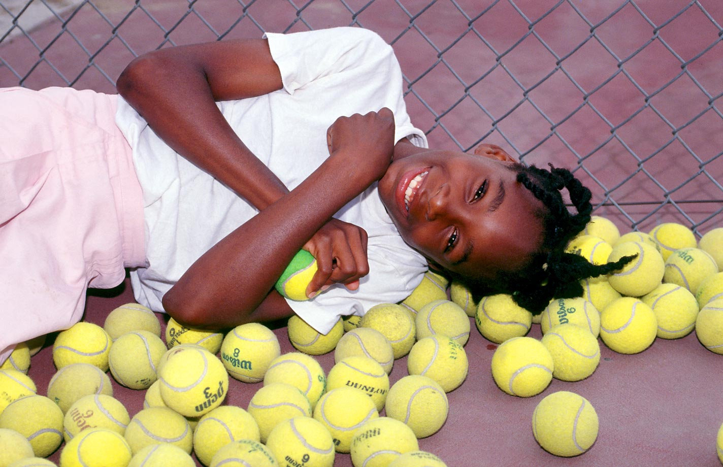 A 10-year-old Williams lies in a pile of tennis balls in Compton, Calif. Soon after this photo was taken, the Williams family moved from Compton to West Palm Beach so Venus and Serena could attend Rick Macci's tennis academy.