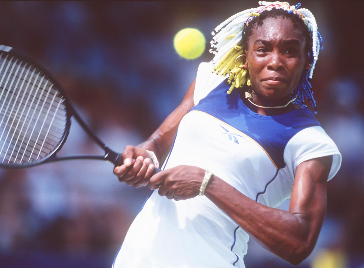 Williams hits a backhand during the Adidas International event in Sydney, Australia. Her beaded hair would spark a fashion phenomenon.