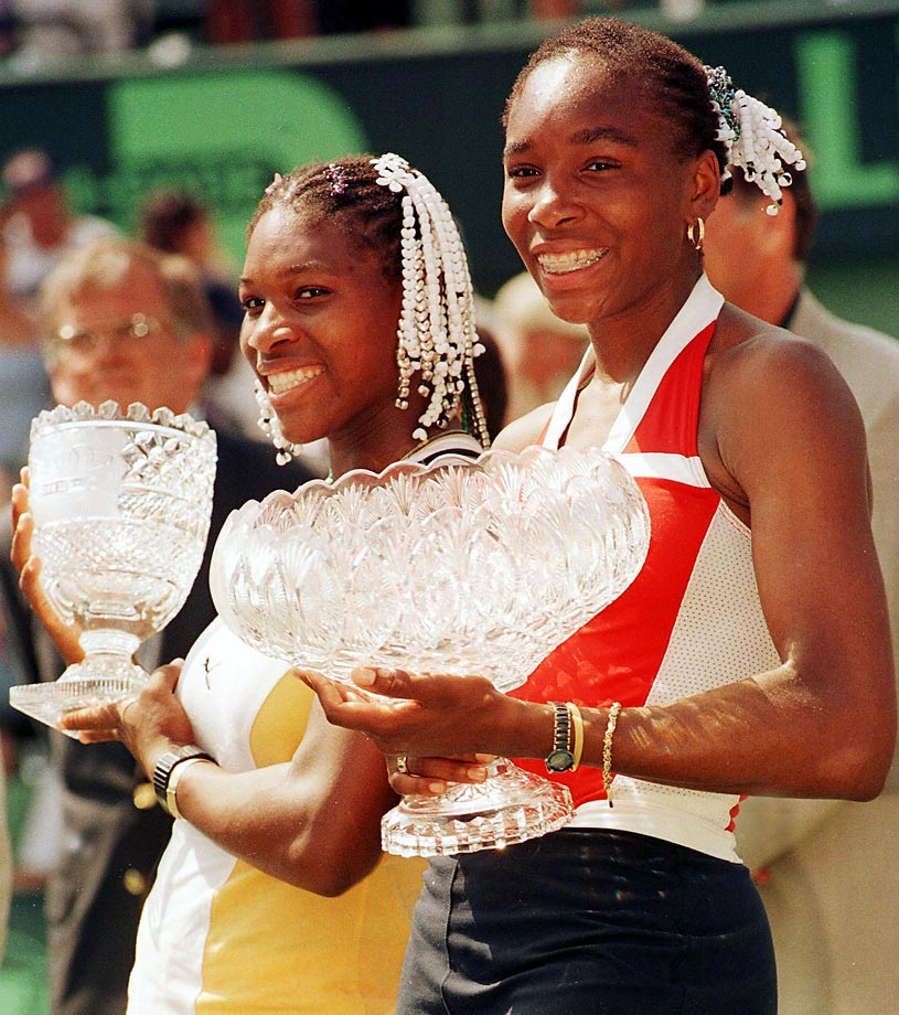 Venus and Serena hold up their trophies after the finals of the Lipton Tennis Championships. Venus defeated her sister in the finals, 6–1, 4–6, 6–4. It was her third title of the year and 10th of her career.