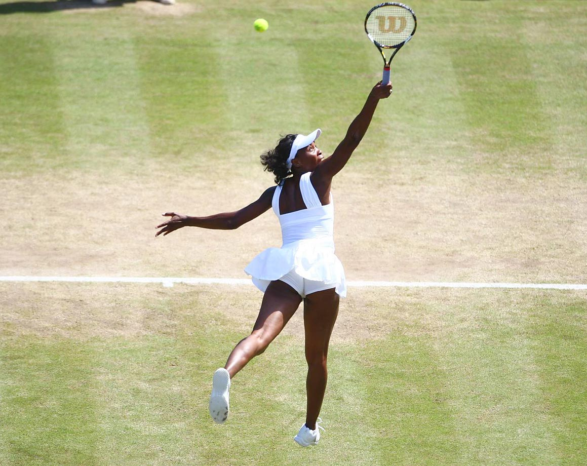 Williams stretches to return a point against Tamarine Tanasugarn, whom Williams beat in straight sets to advance to the Wimbledon semis. Never dropping a set, she would go on to beat her sister in the finals, 7-5, 6-4. The two sisters hadn't played each other in a Grand Slam final since 2003, and Venus hadn't won since 2001.