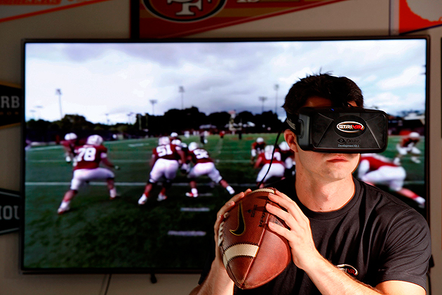 Screen Time: The STRIVR system, demonstrated here by Derek Belch's brother Danny, was specifically designed to help teams train without contact.