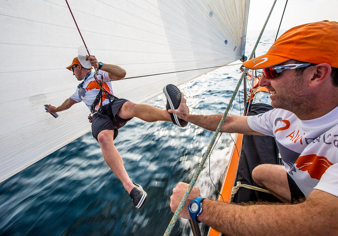 Dave Swete, who must have lost the toss, gets a hand from Seb Marsset while he repairs a rip in the A3 sail during Leg 3 of the Volvo Ocean Race 2014-15.