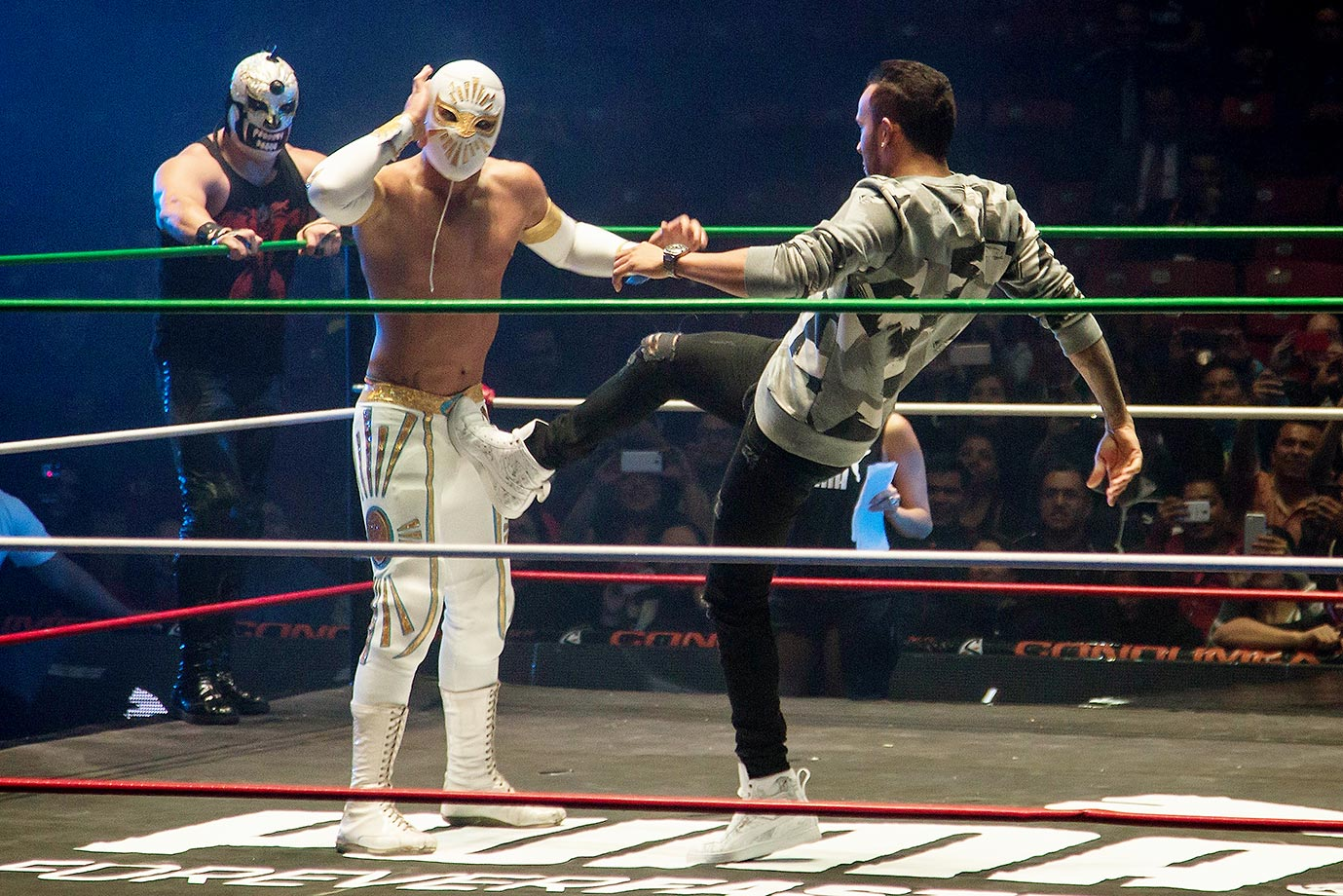 "Lewis Hamilton pretends to fight with Mexican ""Lucha Libre"" wrestler Mistico during a promotional event in Mexico City.  Mexico held its first Formula One race in 23 years on Nov. 1."