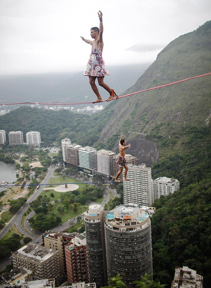 Participants balance on slacklines during the Highgirls Brasil festival in Rio de Janeiro. The event was femaled-focused and allowed men to participate in female attire.