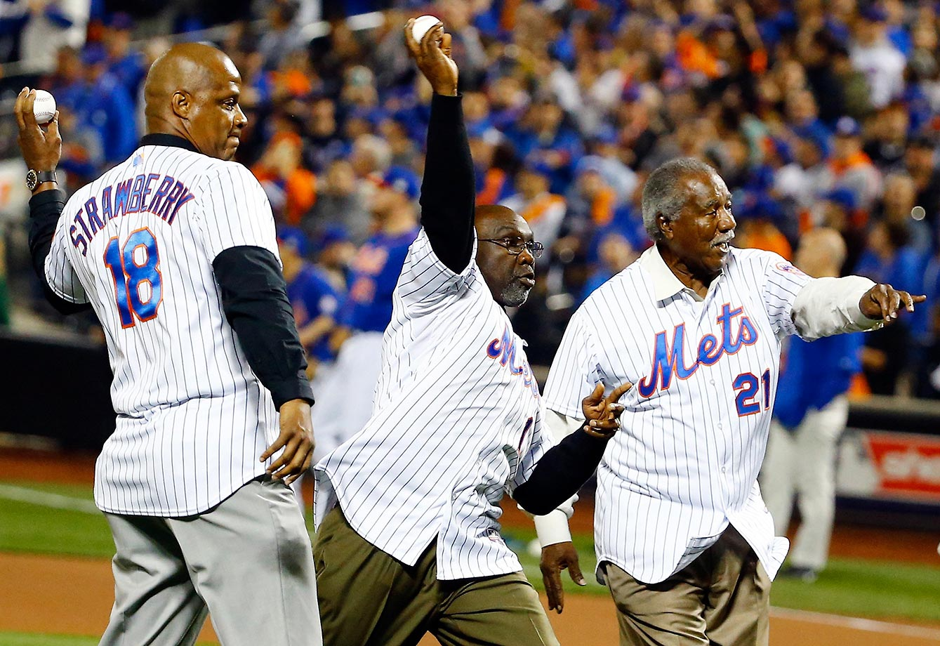 Let's see if the catcher can catch three balls at once. New York Mets former players Darryl Strawberry, Mookie Wilson and Cleon Jones throw out the ceremonial first pitch before Game 5 of the World Series.