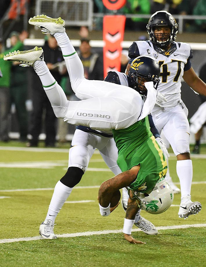 Vernon Adams Jr. of the Oregon Ducks flips into the endzone for a touchdown in a game against the California Golden Bears.
