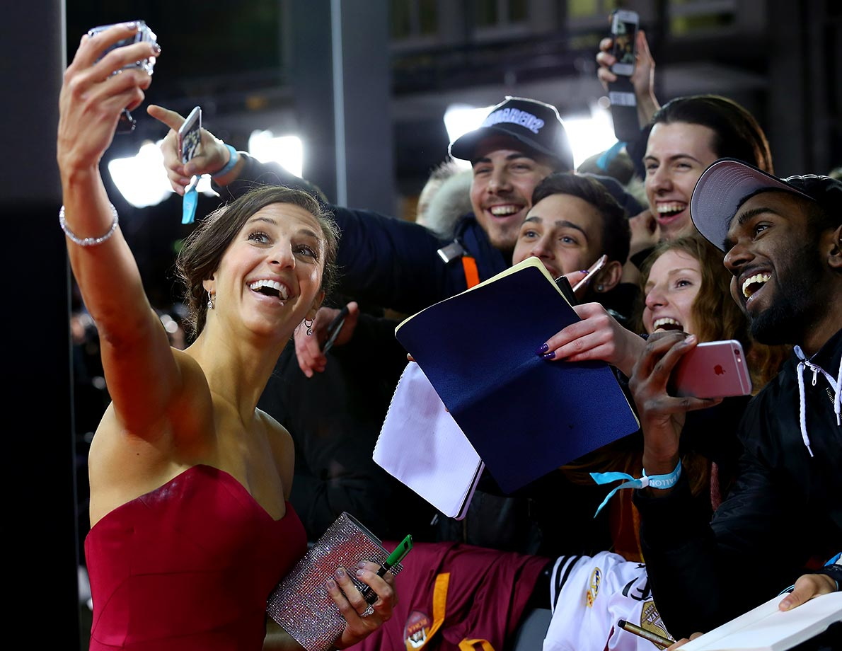Carli Lloyd takes a selfie with fans as she arrives for the FIFA Ballon d'Or Gala in Switzerland.