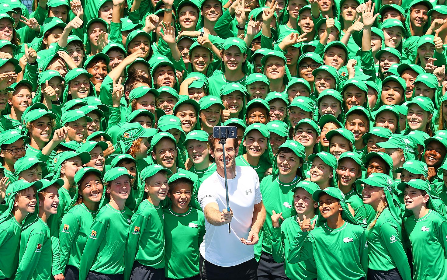 Andy Murray takes a selfie with ballkids while at the Australian Open.