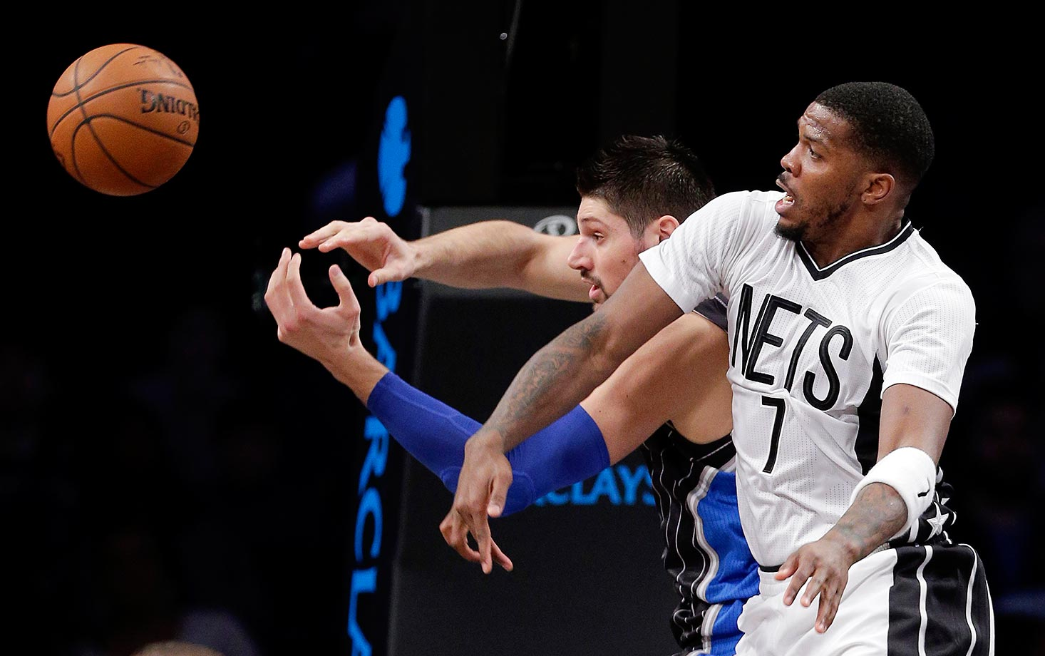 Nikola Vucevic of the Orlando Magic and Joe Johnson of the Brooklyn Nets battle for a rebound.