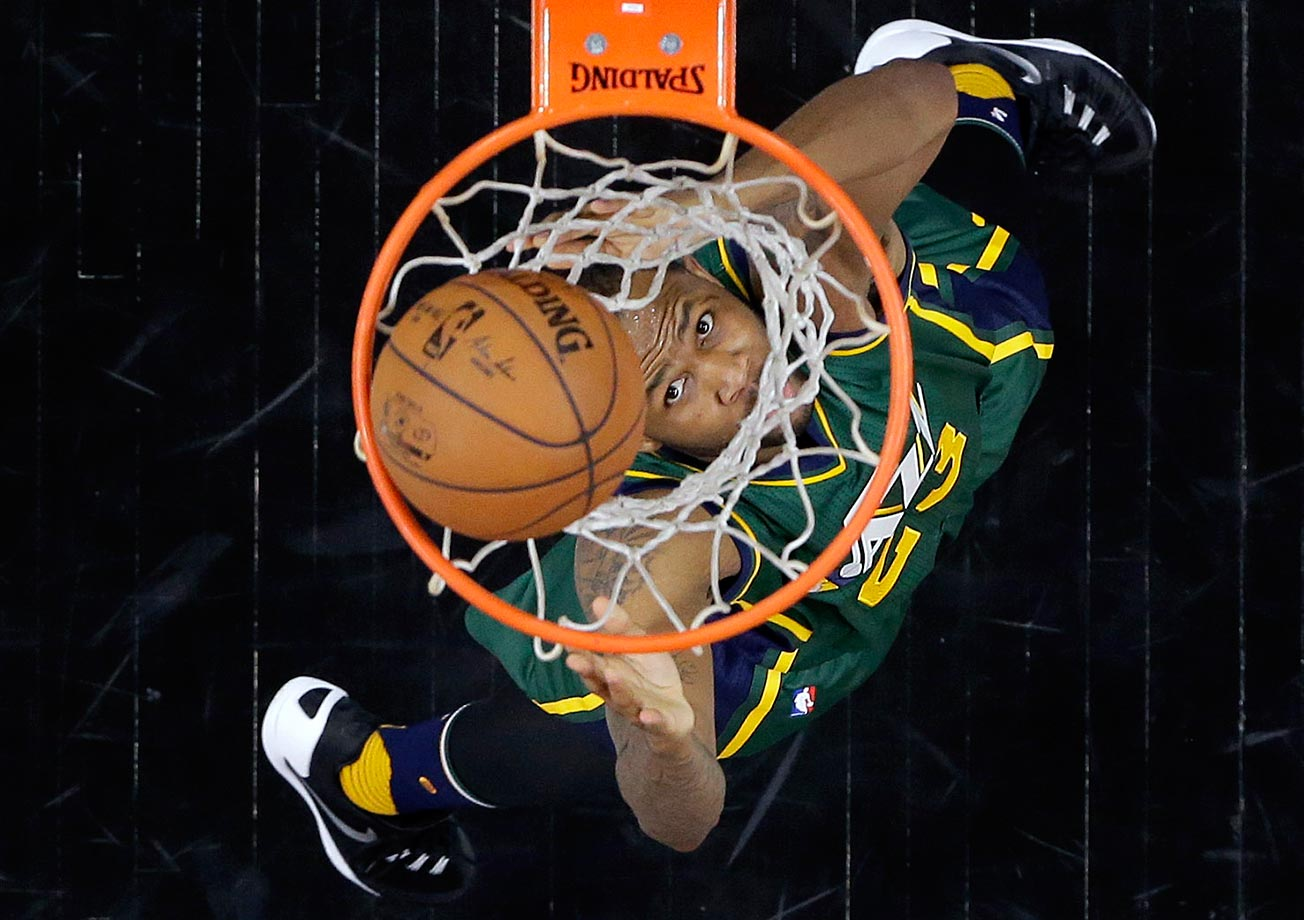 Chris Johnson of the Utah Jazz peeks through the hoop during a game against the San Antonio Spurs.