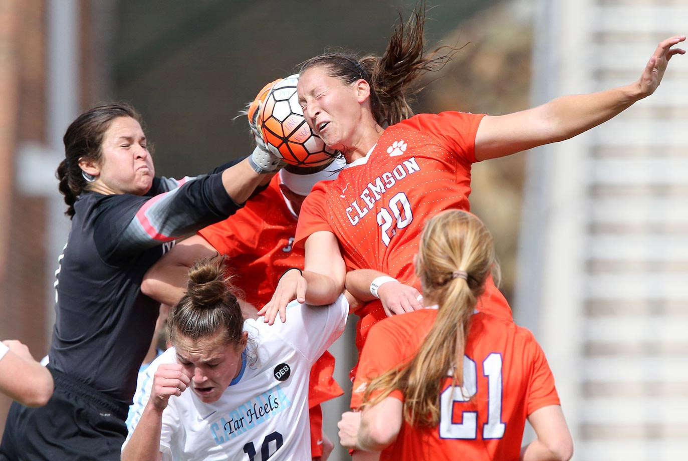 Goalie Bryane Heaberlin of North Carolina jams the ball into Jenna Weston of Clemson.