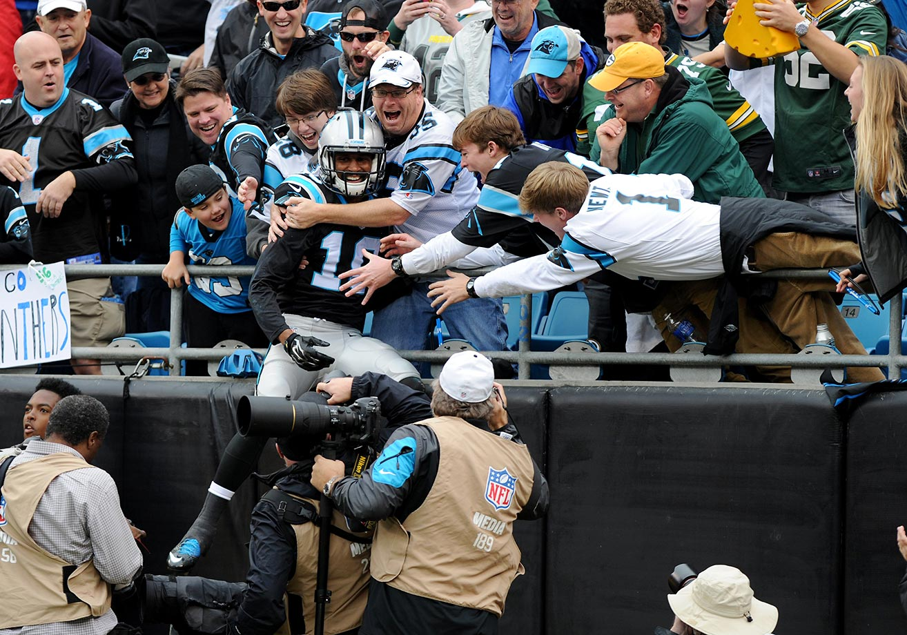Corey Brown of the Carolina Panthers leaps into the crowd after scoring a touchdown against the Green Bay Packers.