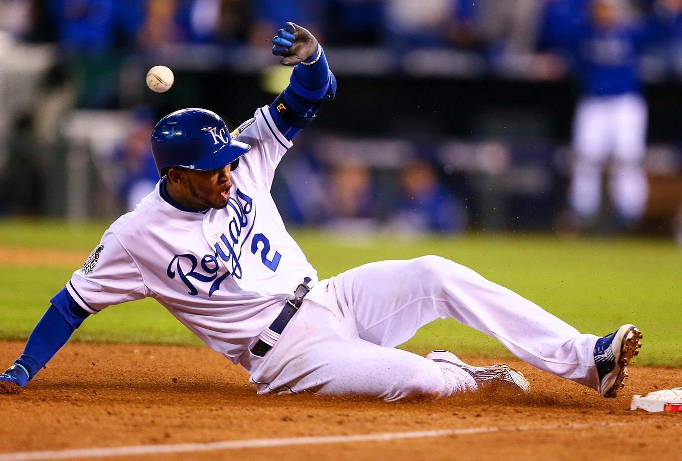 Kansas City Royals shortstop Alcides Escobar slides into third base in the eighth inning of Game 2.
