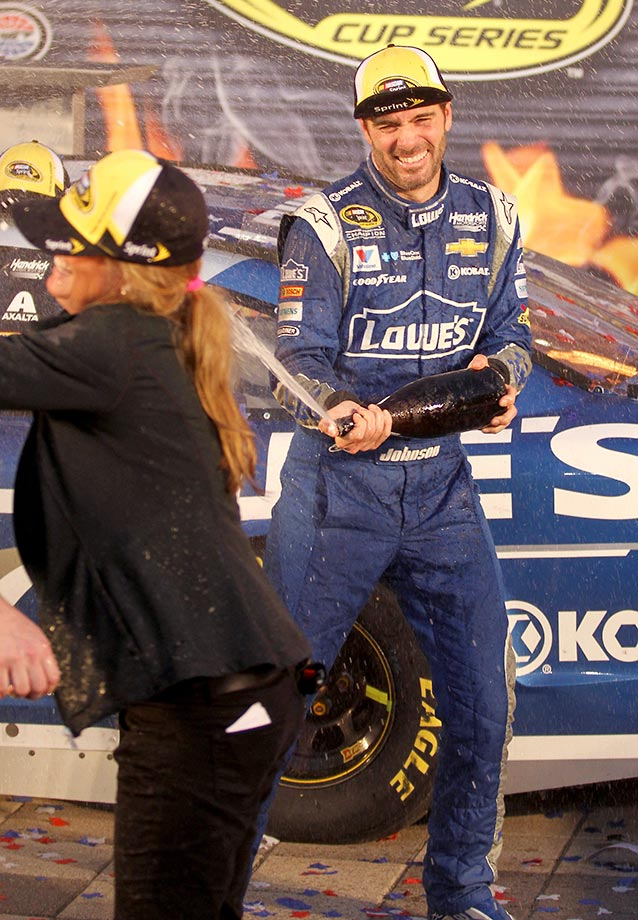 Jimmie Johnson celebrates winning the Sprint Cup Series AAA Texas 500.